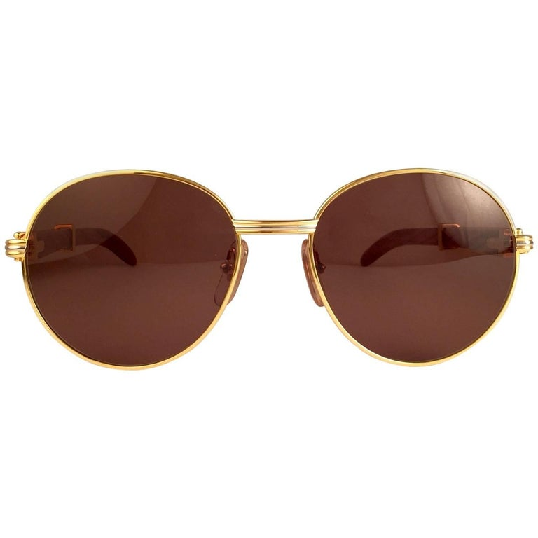 New Cartier Wood Bagatelle Round Gold & Precious Palisander 52mm Brown Lens In New Condition For Sale In Amsterdam, Noord Holland