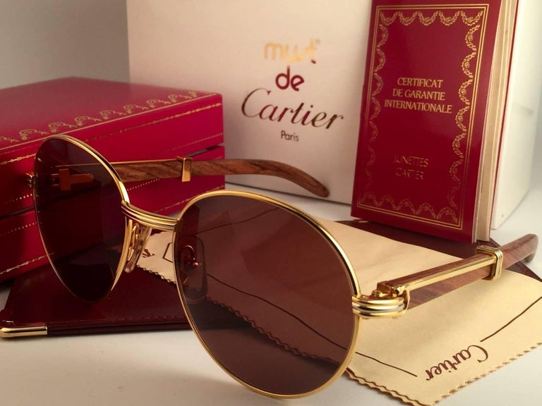 Women's or Men's New Cartier Wood Bagatelle Round Gold & Precious Palisander 52mm Brown Lens For Sale