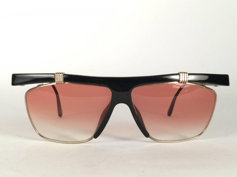 New Vintage Christian Dior 2555 Black frame with spotless light gradient lenses.   Made in Germany.   Produced and design in 1970's. Comes with its original silver Christian Dior Lunettes sleeve.