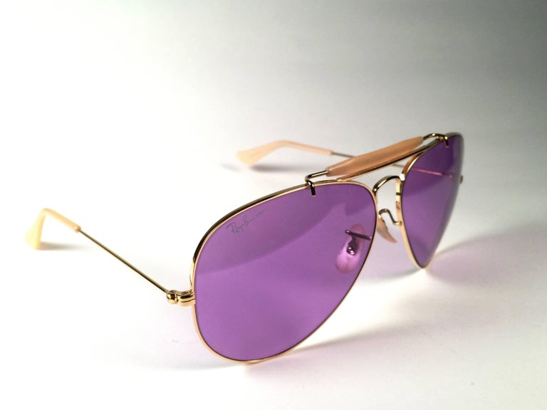 New, rare and sought after Vintage Ray Ban Purple Chromax.  58Mm outdoorsman gold frame holding a pair of purple Chromax B&L etched lenses.  New, never worn or displayed, this item is a superb find. It may have minor sign of wear due to storage.