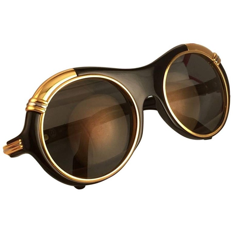 New from ,  Original Cartier Diabolo Art Deco Sunglasses with spotless amazing brown gold mirrored (uv protection).  Frame has the famous real gold and white gold accents in the middle and on the sides. All hallmarks. Cartier gold signs on the