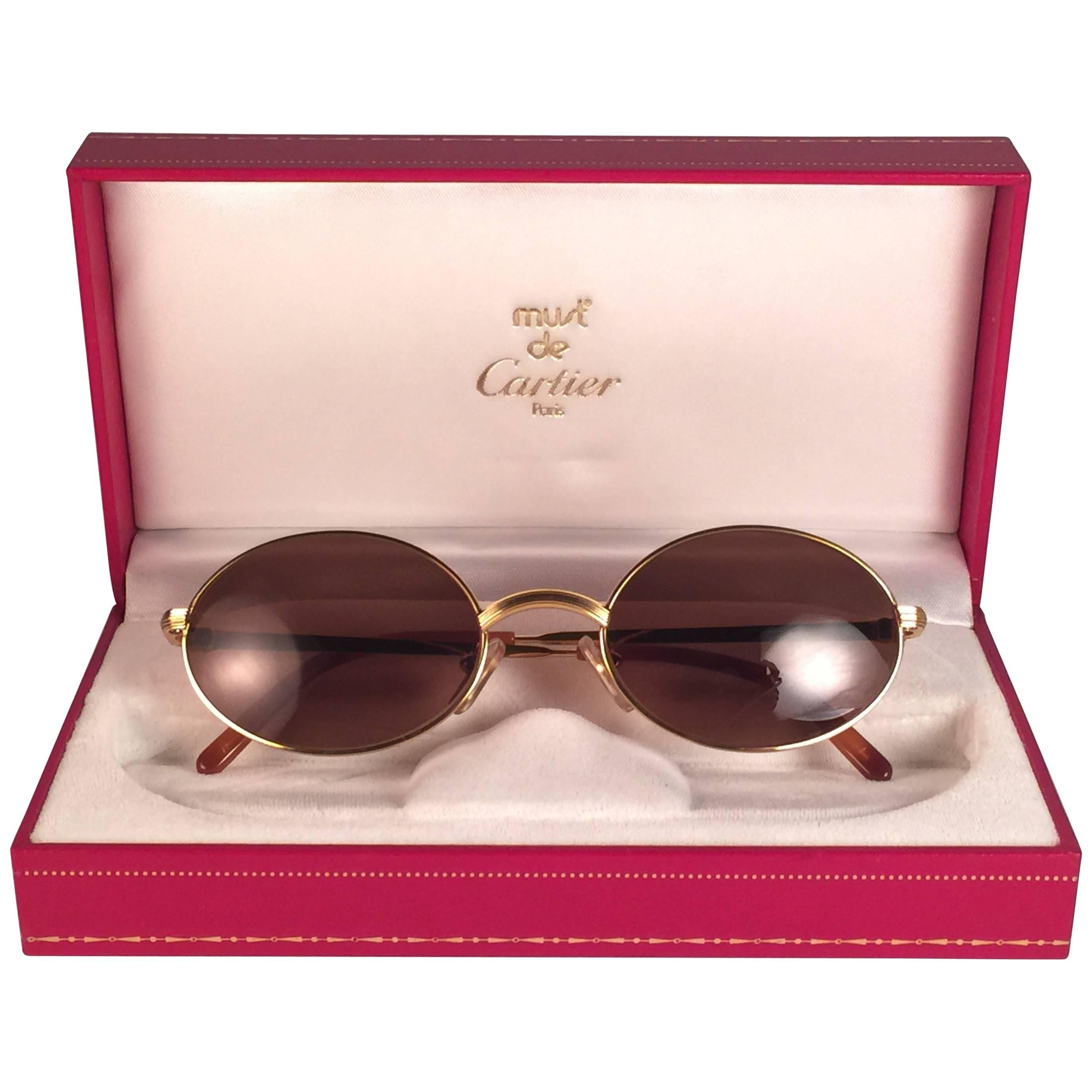 78f1aea1783f New Vintage Cartier Scala 45mm Gold Rimless Brown Lens Case France  Sunglasses For Sale at 1stdibs