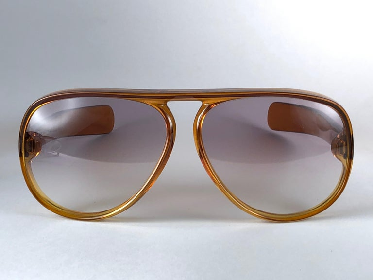 New Vintage Christian Dior D60 J10 sunglasses oversized translucent gradient honey amber aviator with spotless light brown gradient lenses 1970's.  Made by optyl.  Manufactured in austria   Strong and stunning oversized frame. A must have piece!