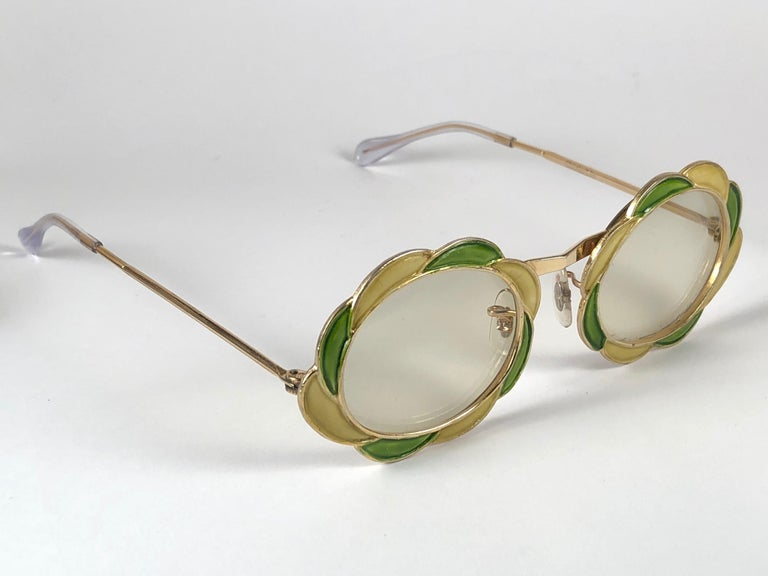 Ultra rare pair of Christian Dior Sunglasses circa 1960's.  This is a seldom and rare piece not only for its aesthetic value but for its importance in the sunglasses and fashion history.    Delicate enamel o cast iron frame emulating a delicate