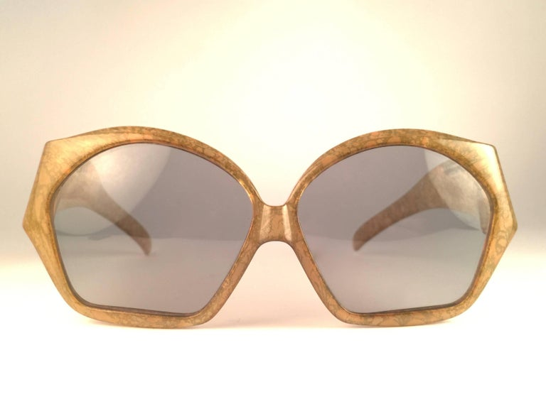 New Vintage Christian Dior 2028 60 Jasped marbled green frame with spotless light grey lenses.   Made in Germany.   Produced and design in 1970's.  New, never worn or displayed. Comes with its original silver Christian Dior Lunettes sleeve.