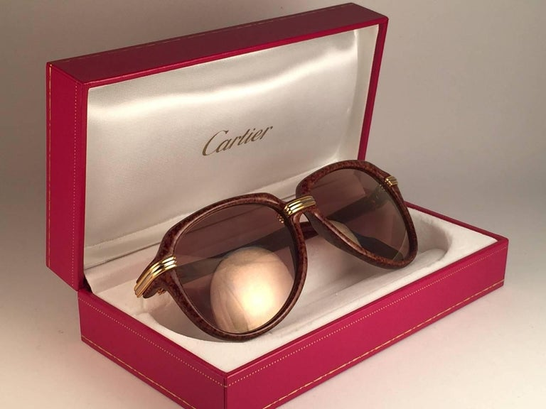 Collectors Item. Unique and original Cartier Aviator Vitesse sunglasses, the Brown Jaspe Edition with yellow and white gold accents. Frame is with the sides in gold. All hallmarks. Cartier gold signs on the ear paddles. Both arms sport the c from