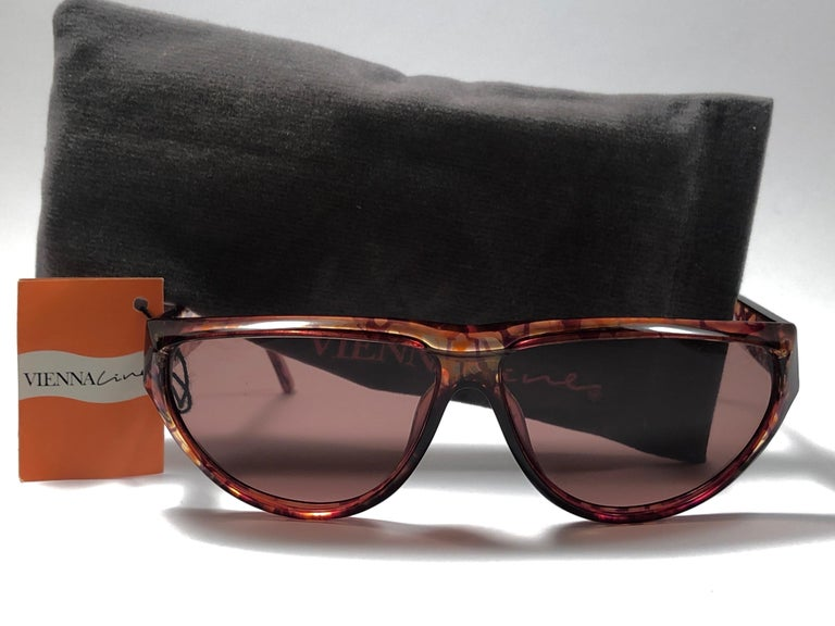 New Vintage Sunglasses By Viennaline. Translucent camouflage coloured frame.  Made in Germany 1980's.   New, never worn, or displayed.  Frame may show minor sign of wear due to storage.   Made in Germany.