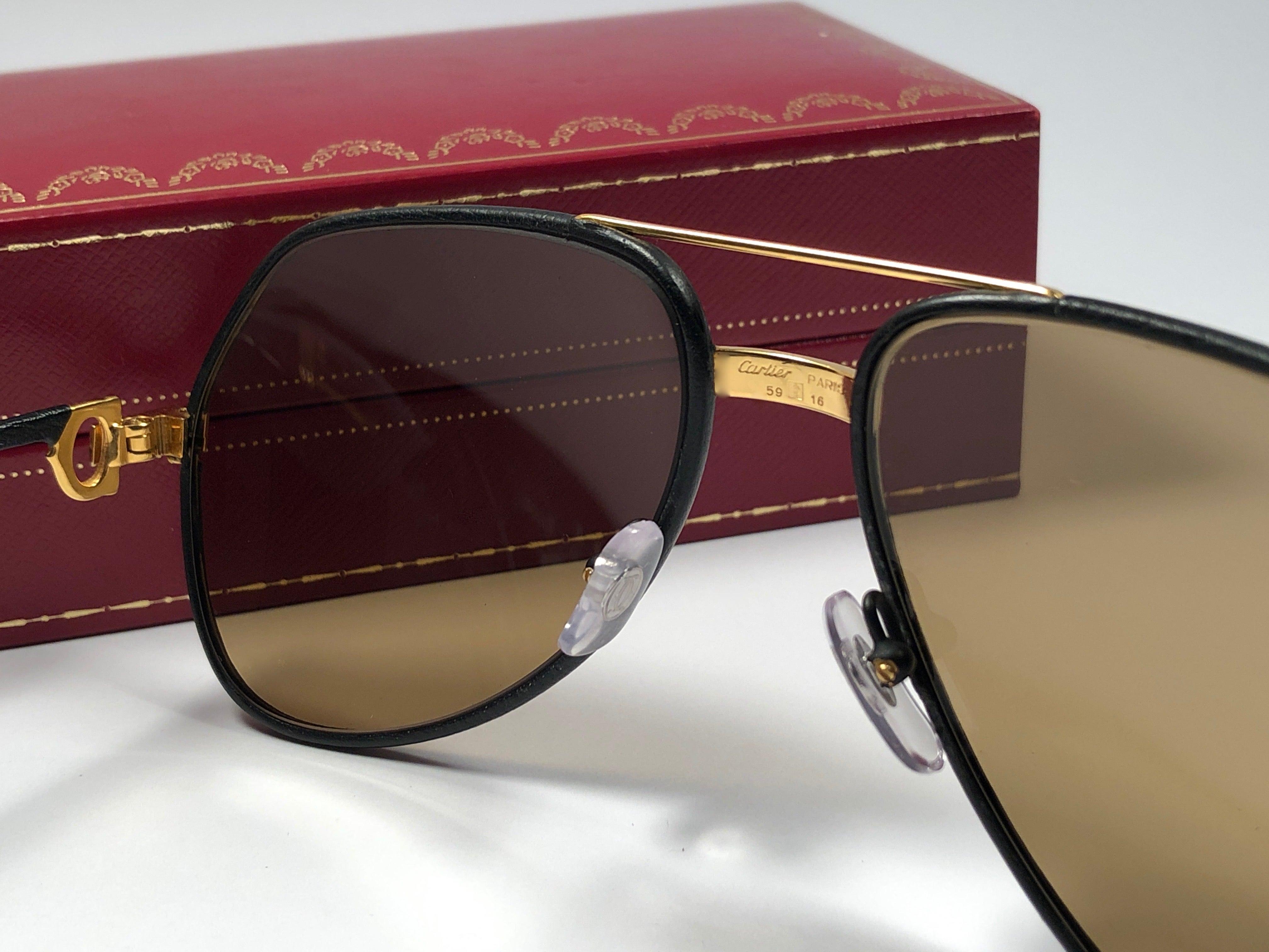2526842af1 Rare Vintage Cartier Santos Screws Leather Edition 59mm 18K Sunglasses  France For Sale at 1stdibs