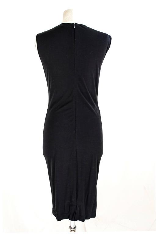 Beautiful black sheath dress Gianfranco Ferrè vintage 1980s at armholes with zipper on the back.  Measures:  Shoulders: 40 cm Armpit to armpit: 42 cm Total lenght: 108 cm Sleeves: no
