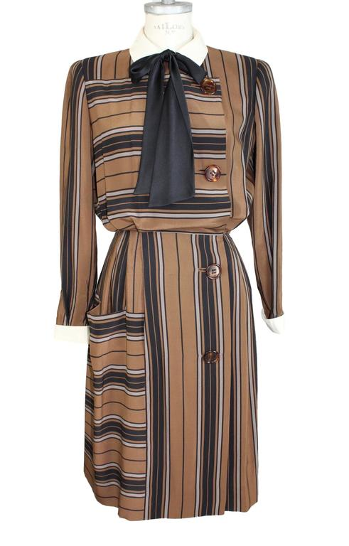 Salvatore Ferragamo dress vintage 1980s, 100% pure silk, brown and black stripes. Front pocket. The dress closes with laterally buttons and clips. Fully lined. Collar classic ivory color. Excellent vintage condition.  Size 44