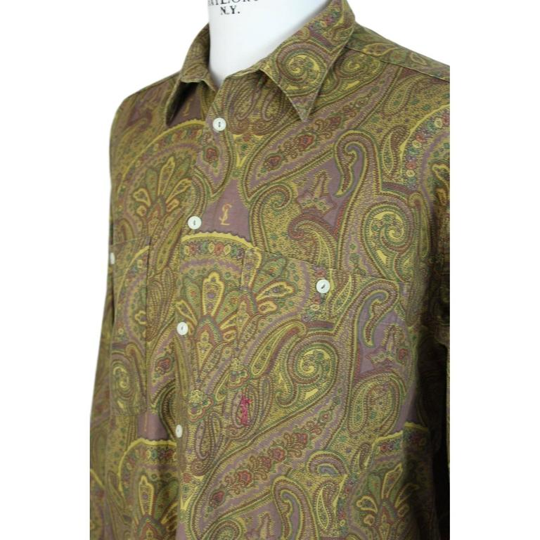 Yves Saint Laurent men's shirt multicolor cotton size XL, vintage 1980's paisley pattern. The logo is embroidered in different parts of the shirt. Excellent vintage condition, last front button missing  Size XL  Shoulder: 54 cm. Armpit to armpit: 62