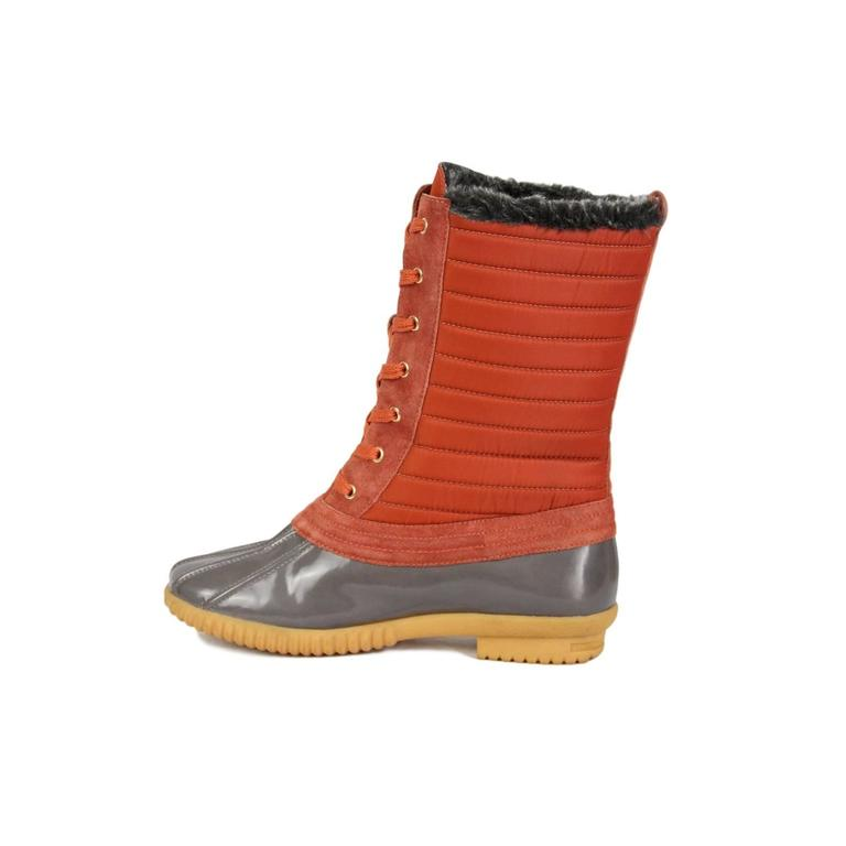 The Marc by Marc Jacobs duck boot belongs in every woman's closet, especially for those still experiencing a little cold weather. I know singer Christina Aguilera is a fan. This rubber round toe duck boot features a nylon lace up front, shearling