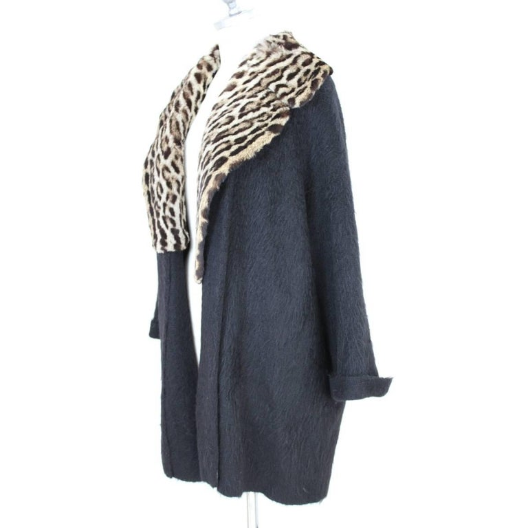 Gianfranco Ferrè vintage jacket for women. In very warm and precious angora wool. The leopard fur collar. The fit is like poncho, without buttons. Black, made in Italy, size 44. Excellent vintage condition.  Size 44 It 10 Us 12 Uk 38 Fr 40