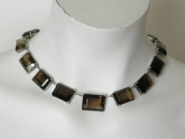 """This impressive choker necklace has fifteen links with emerald cut smoky quartz set in sterling. These natural stones vary in size and also a bit in color and translucency. The clasp is marked """"Japan Silver"""".  Please contact us if you have any"""