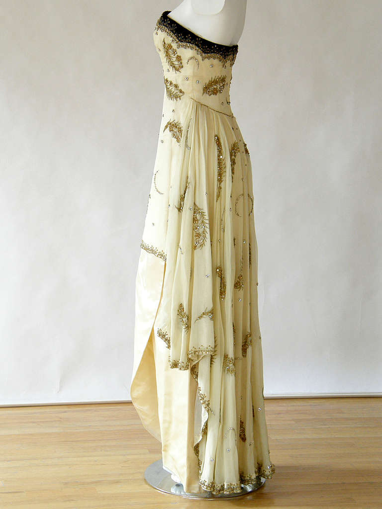 Extremely elegant, evening gown designed by Cecil Beaton. This new/old stock gown retains its original tag from the famous