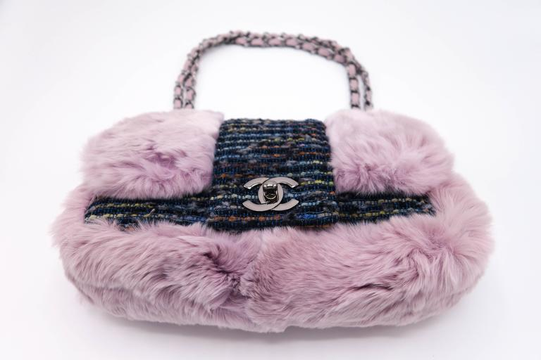 """Brand new beautiful and rare Chanel glicine lapin & tweed single flap purple fur bag. The fur is extremely soft. Shoulder strap measures 9""""L. Must have for your winter wardrobe.   Comes with authenticity card, dustbag and box."""