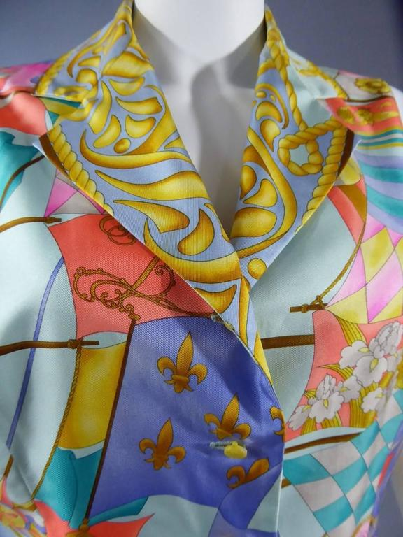 Circa 1980/1990  France  Sleeveless Léonard top or blouse in 100% silk with marine motif, sailboats, compasses, flags ... Closes with four gold pearl buttons.  Excellent condition.