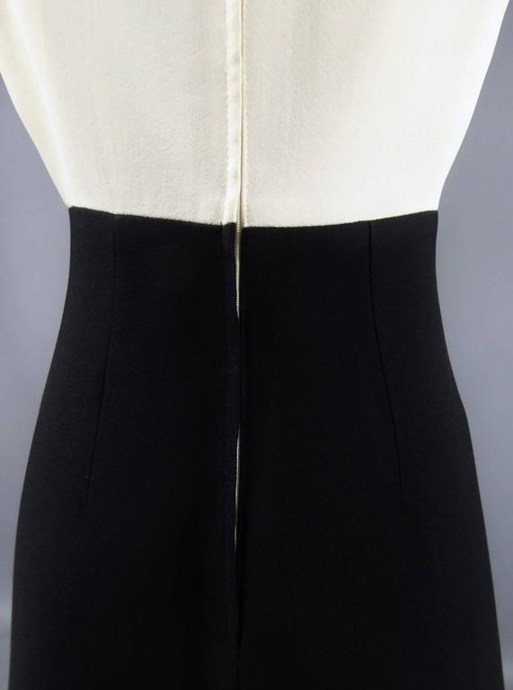 Circa 1975/80  England  Louis Féraud dress at Rembrandt, graphic design in thick black crepe on the skirt and white on the top. Heavy fabric reminding Gazar, probably supplied by the Japanese house Shimbo Fabrics (See photo). Trapezoid shape on the