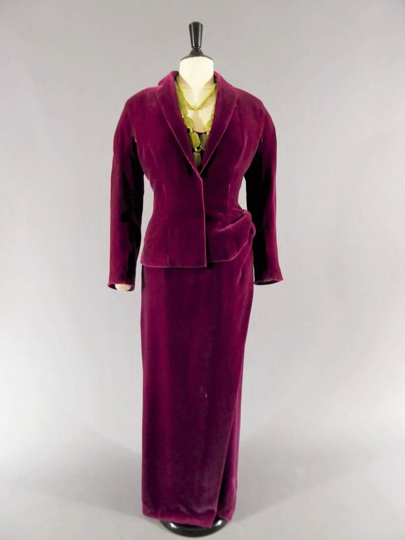 Jean-Paul Gaultier Haute Couture Four pieces belonging to catherine Deneuve Paris 2004 Aubergine velvet ensemble lined with light green chiffon silk. Dress with round neck, sleeveless, straight skirt with draped effect as a knot. Jacket with shawl