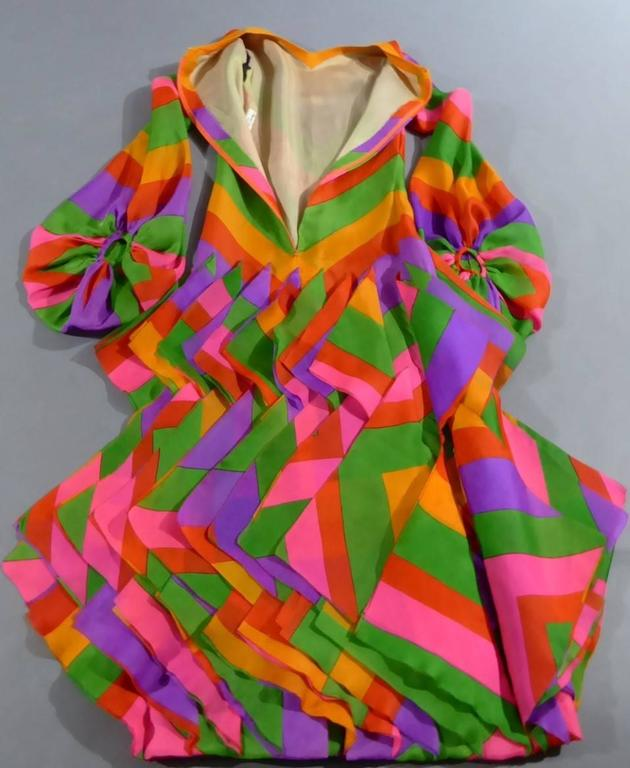 Circa 1970  France Haute Couture  Amazing Haute Couture long evening dress by Pierre Cardin Paris and dating from the seventies. Multicolored printed organza with large chevrons in yellow, orange, purple, green, fuschia and vermillon. Three ranks of