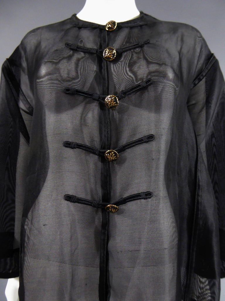 Circa 1980  France  Black net nylon blouse with details of black and gold buttons and Chinese style trimmings. No size on it, but french Rive Gauche label. excellent condition and color, very clean.  Dimensions: Equivalent french size 38/40. Bottom