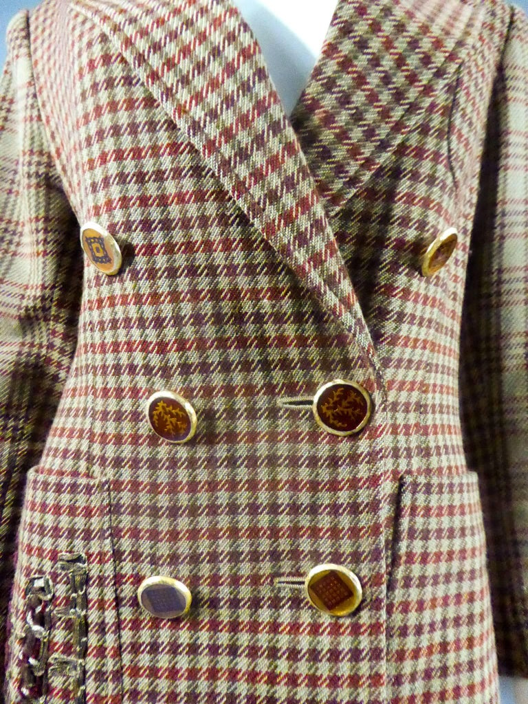Circa 1980  France Jacket by Christian Lacroix Paris 90s in brown wool and hound of wine, mauve and buff. Small epaulettes. Velvet ribbons, gold metal and wool are applied to the right pocket and the left sleeve. Buttons in painted enamel and bronze