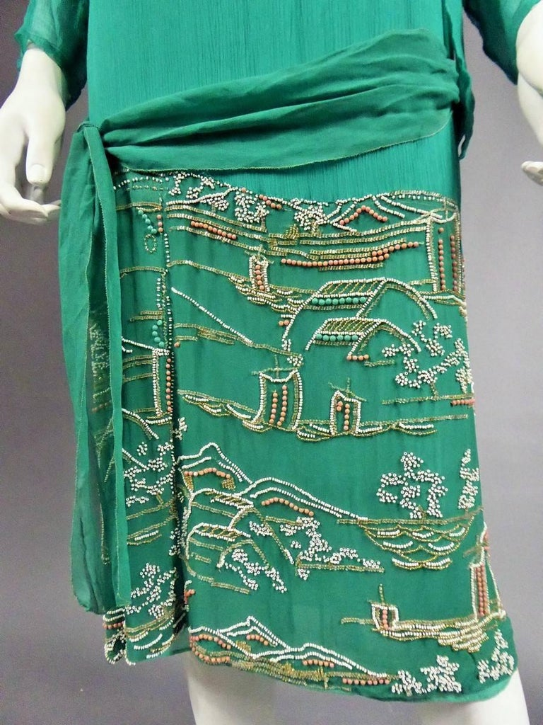 France Haute Couture  Japanese-style Circa 1925  Silk crepe dress elegantly tied on the hips and dating from the Art Deco Period. Sleeveless dress in taffetas and green water / turquoise muslin. Matching dress with long sleeves and two scarves.