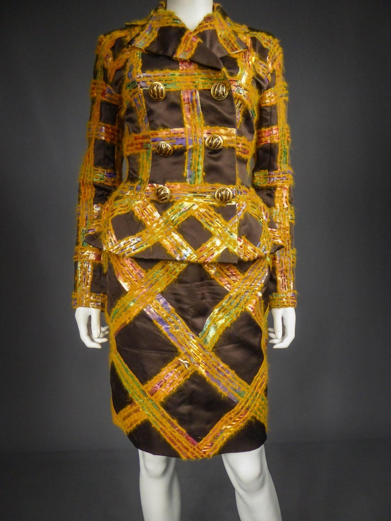 Circa 1990  France  Gorgeous skirt suit Ted Lapidus by Olivier Lapidus of the 90s. Clever shaped chocolate silk satin entirely embroidered with a check pattern in orange angora and iridescent plastic, embroidered with multicolored pearls. Jacket
