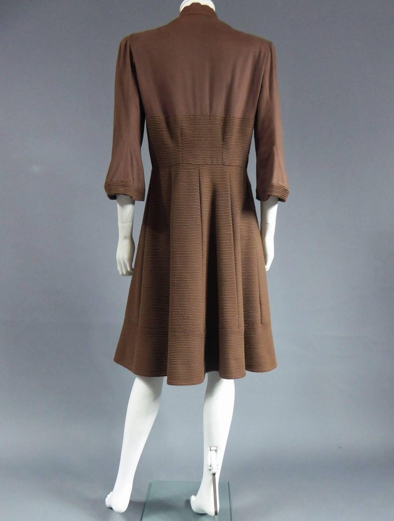 Circa 1944/1948 France Haute Couture Interesting Haute Couture coat dress CARVEN, 6 Round Point Champs Elysee Paris, dating from the period of the Liberation of France. Very fine chamois alpaca à bourrelets with matching threads sewn in parralel