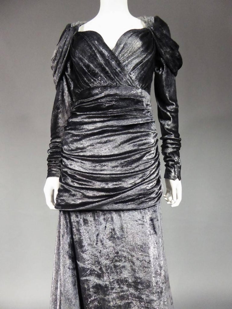 Collection Quarante Fall 1971  France  An evening dress from the Quarante or Libération Fall Collection, which caused a scandal in 1971 when it was presented to the press. Slashed train dress with anthracite gray velvet and silver lurex. Bust and