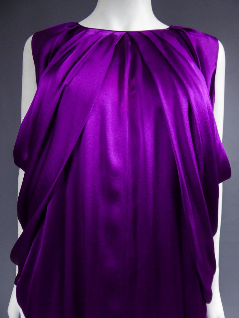 Spring Summer 2008 Collection France  Yves Saint Laurent sleeveless dress in amethyst silk satin. Spring Summer 2008 collection by Stéfano Pilati. Variation passage no. 14. Round neckline underlined by flat pleats with draping effect all along the