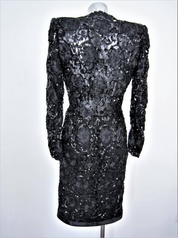Stunning Rare Yves Saint Laurent Patron Original Paris lace and sequin evening black dress, circa 1980. Very elegant and particular couture construction, Inner belt to tie the waist. Very good conditions, only little pull on the sequin and little