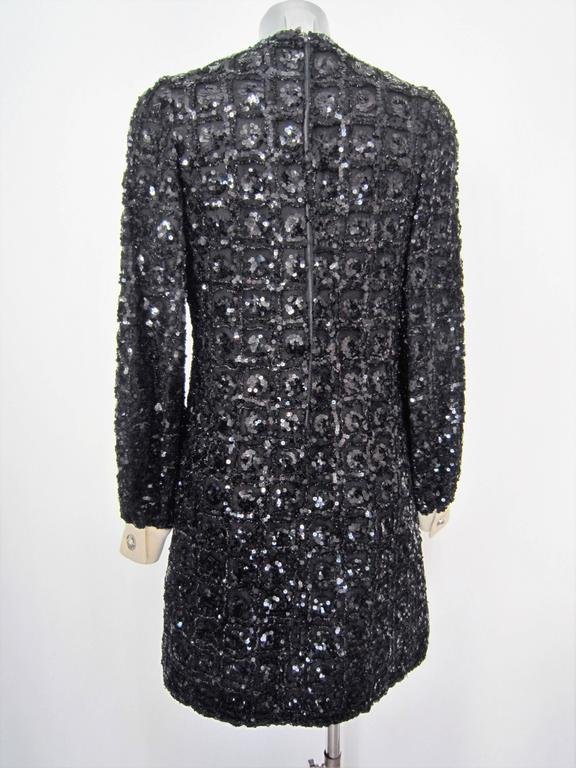 Beautiful black sequin dress with white fabric cuffs ,1960's Very nice metal buttons  Size: no size, but it seems to be a 40-42 it  Brand: tailored  Material: tulle, sequin  Condition: Good condition, Some light sign of wear ,some little holes in