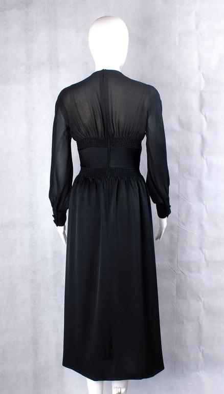 Wonderful Valentino Couture black silk gown, 1970s The bodice is made of transparent black silk with origami motives embroidered in the middle of the dress.  Size : 40 IT, 8 UK, 4 US Brand: Valentino Couture Material: silk  Condition: Good