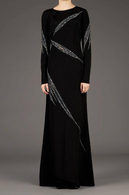 Emilio Pucci Runway Black Embellished Gown. Sexy Slashed Details Accent with Silver / Black Crystals Embellishments. This Sleek Dress Featured Gorgeous Embellishing in a Slashed Sheer Inset Pattern All Over.  IT size 38 - US 4 100% Silk. Double