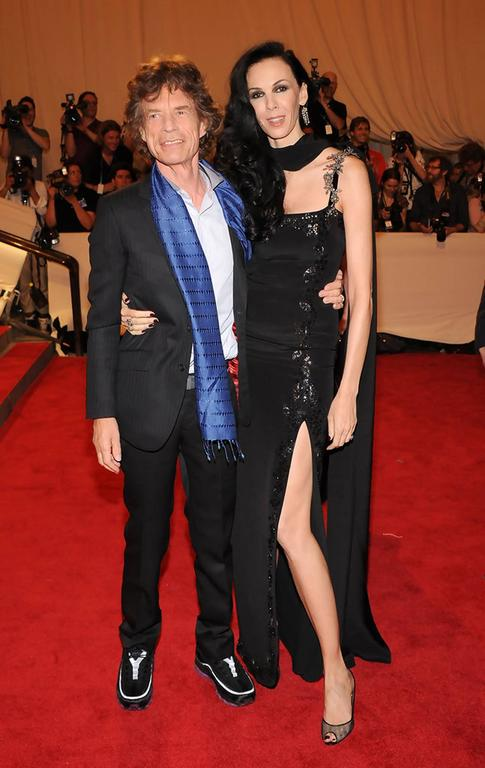 Musician Mick Jagger and designer L'Wren Scott attend the Costume Institute Gala Benefit to celebrate the opening of the