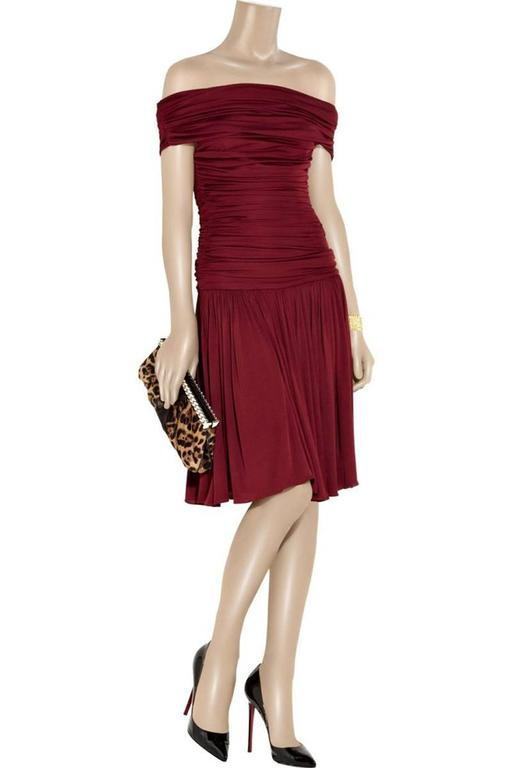 New Giambattista Valli Dress Designer Size 46 - run very small Burgundy satin ruched and off-the-shoulder dress. Giambattista Valli dress has a concealed zip-fastening at side, lined Material: 100% rayon Designer Color: Lipstick Red Length - 35