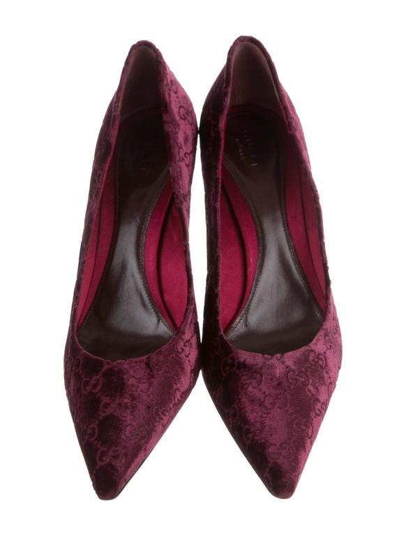 New Tom Ford for Gucci Velvet GG Pumps Highly Collectible Pair from Tom Ford Era Designer size - 11B Color - Black Cherry Velvet with GG Imprint Snakeskin Covered Heel - 3.5 inches Gold-tone Bamboo Detail Leather Sole and Insole Made in Italy New
