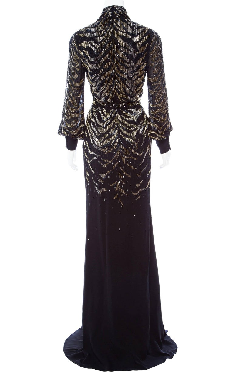 Roberto Cavalli Silk Embellished Kimono Dress. Italian size 38. Tiger pattern dazzling black dress with golden and metallic handcrafted beads. Classy and chic, this Kimono style design is presented with a high leg slit at the front for a dangerous