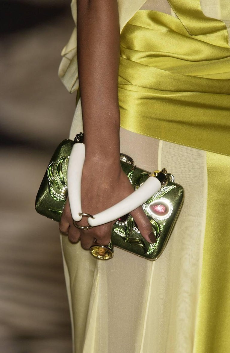 Tom Ford for Yves Saint Laurent Rive Gauche Enamel Jeweled Clutch Bag S/S 2004 Collection Green lacquered metal,  crystal and jewel embellishments, horn top handle, black suede lining and push-lock closure at top. Measurements: L - 7.25 inches, H -