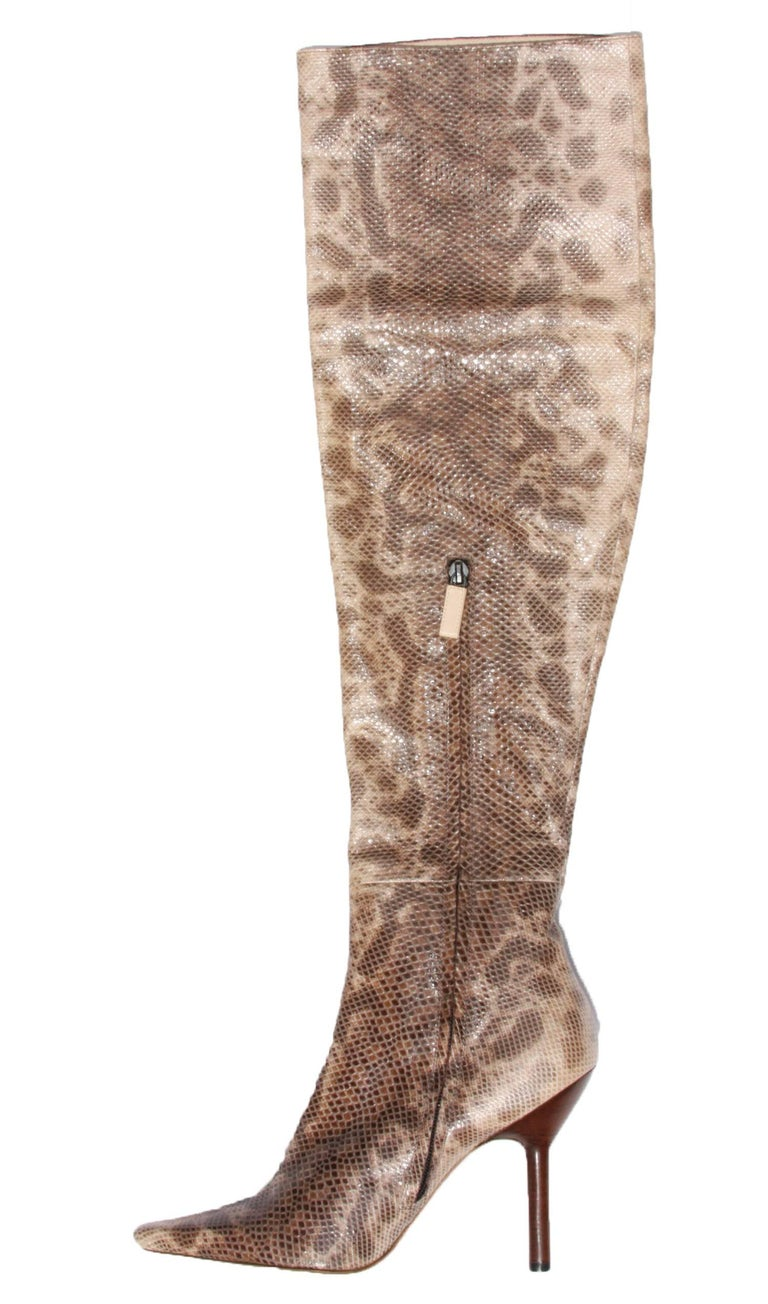 New Tom Ford for Gucci Over Knee Snake Boots F/W 1999 Collection Designer size - 8 B (Euro 38) 100% Water Snake Skin Color - Beige Stacked Heel - 4 inches Zip Closure at Side Made in Italy ​New with original box.