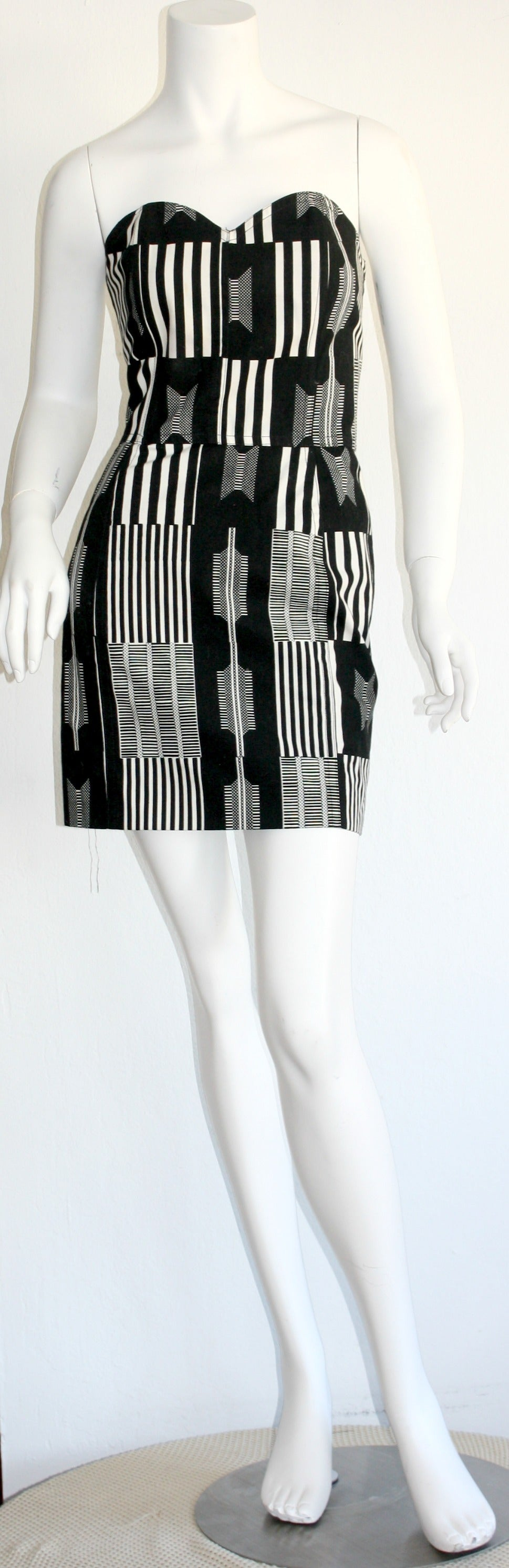 "Incredibly rare vintage Patrick Kelly ""Barcode"" dress! Black and white barcode print throughout. Stunning shape, that is very flattering on the body. Looks great alone, or belted. Fully lined. In great condition. Approximately Size"