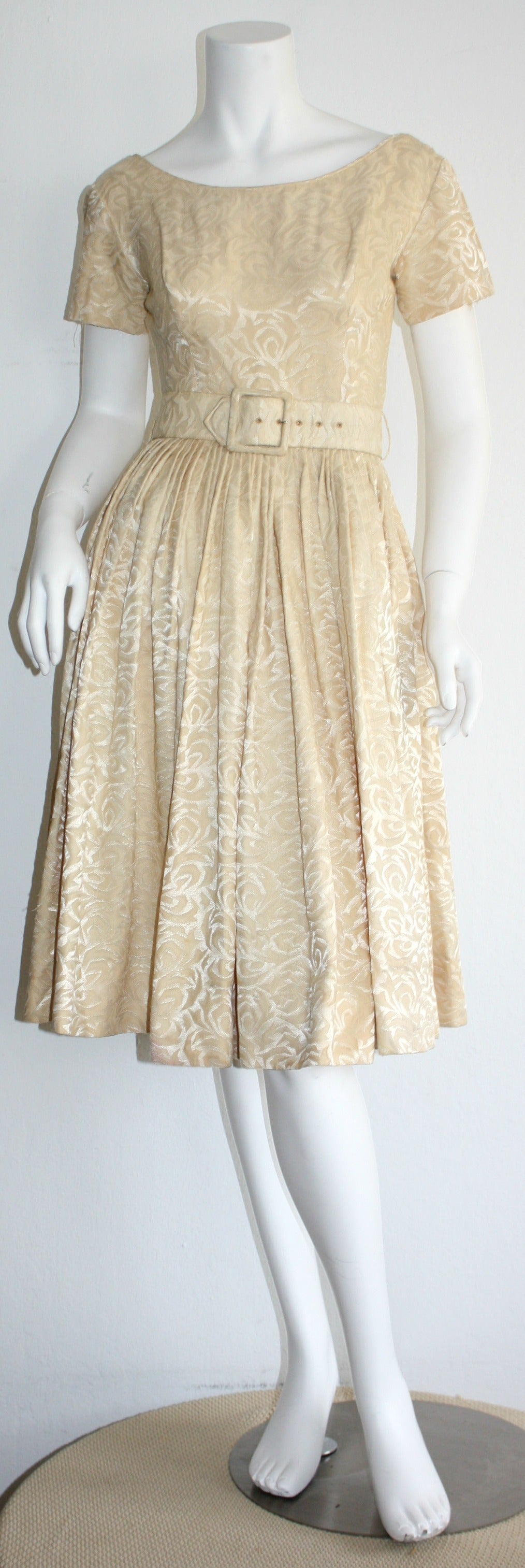 Wonderful vintage 1950s Gigi Young ivory silk dress, with floral background motif. Features detachable belt. Flattering full skirt, that looks great on the dance floor! Also room for a crinoline. Such a pretty, and versatile dress! In great