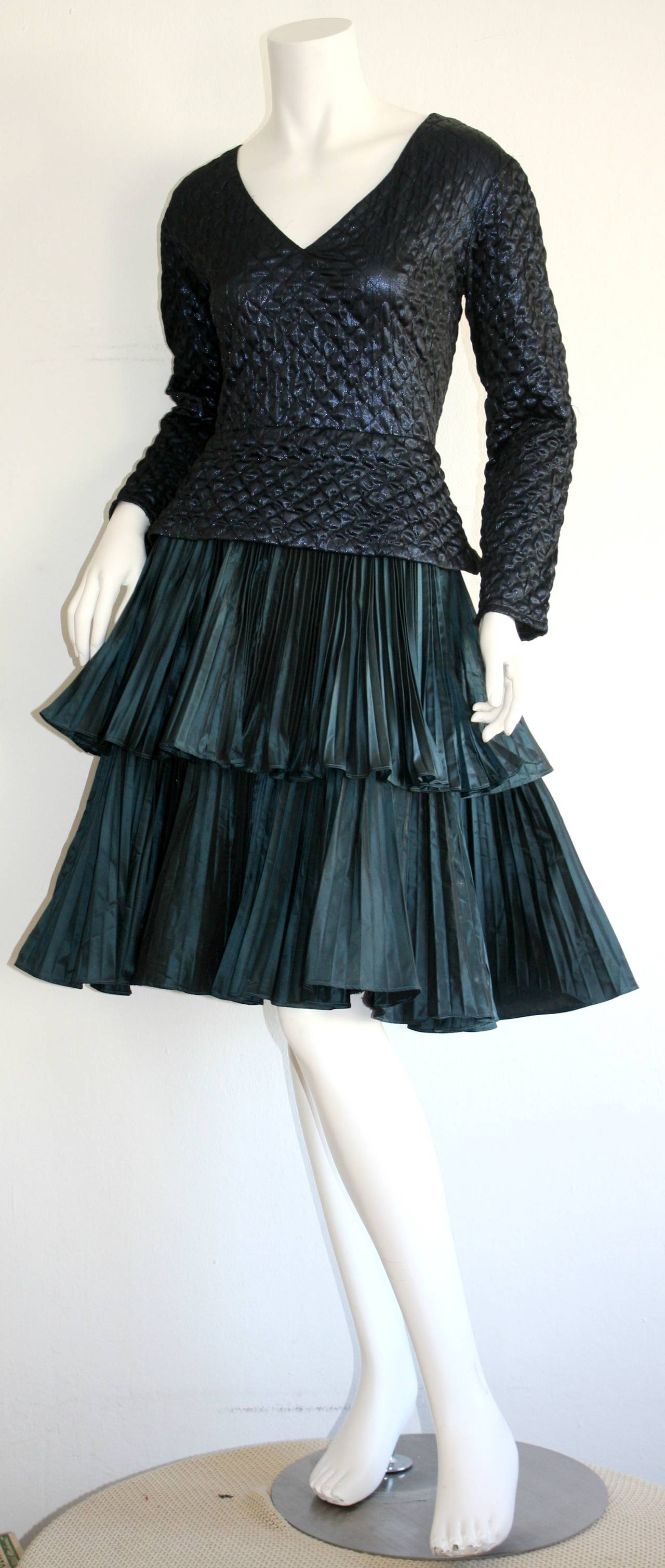 Gorgeous vintage navy blue metallic Bernard Perris dress. Wonderful diamond quilting on bodice, with a dramatic, full accordion pleated tiered skirt. Chic silk covered buttons up the back. 100% silk. Made in France. In great condition. Approximately