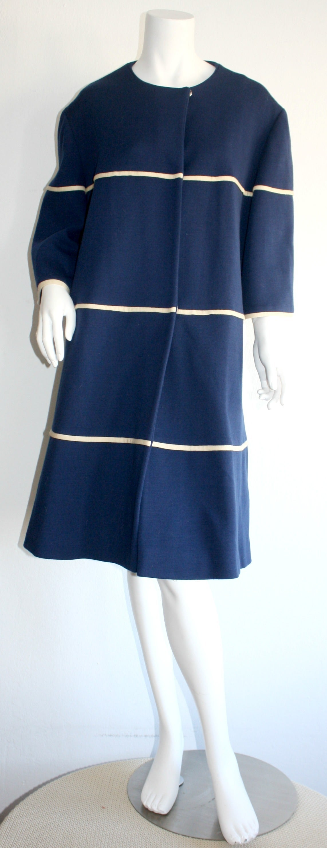 Wonderful vintage 1960s Lilli Ann navy blue swing jacket! Vibrant navy color, with ivory horizontal striped cords. Snaps down the front. Fully lined. In great condition. Will fit most sizes.