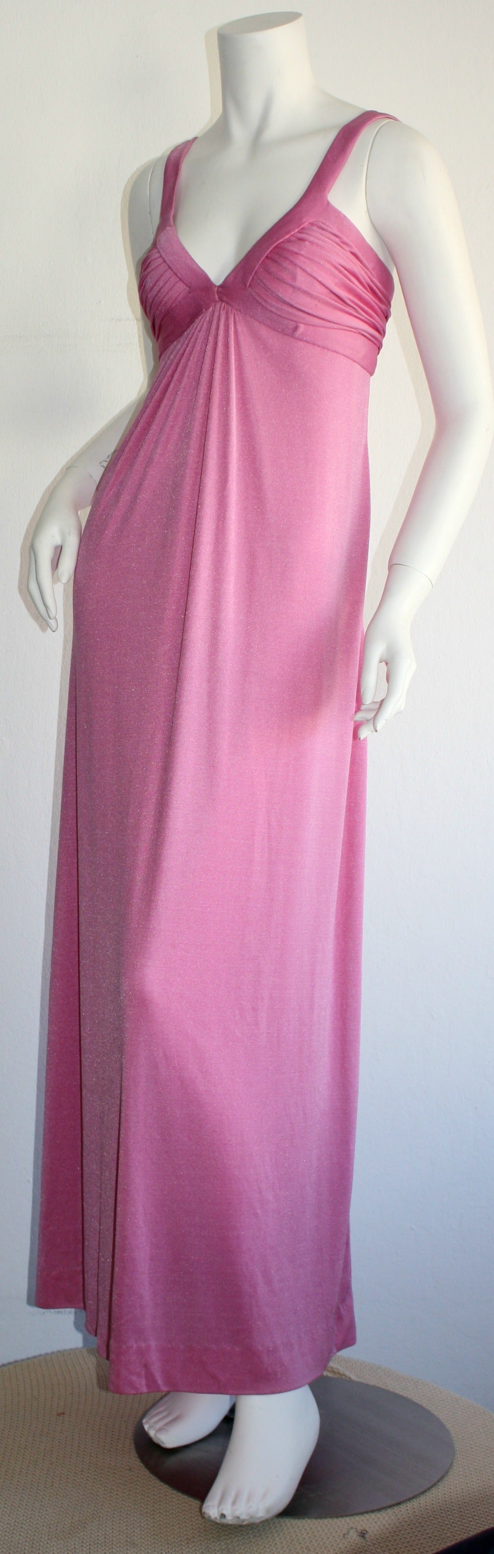 Stunning vintage 1970s Loris Azzaro pink silk jersey gown! Beautiful bodice, with a draped, Grecian/Empire feel to the body. Zipper works great, just could not fit the dress form. In great condition. Made in France. Approximately Size