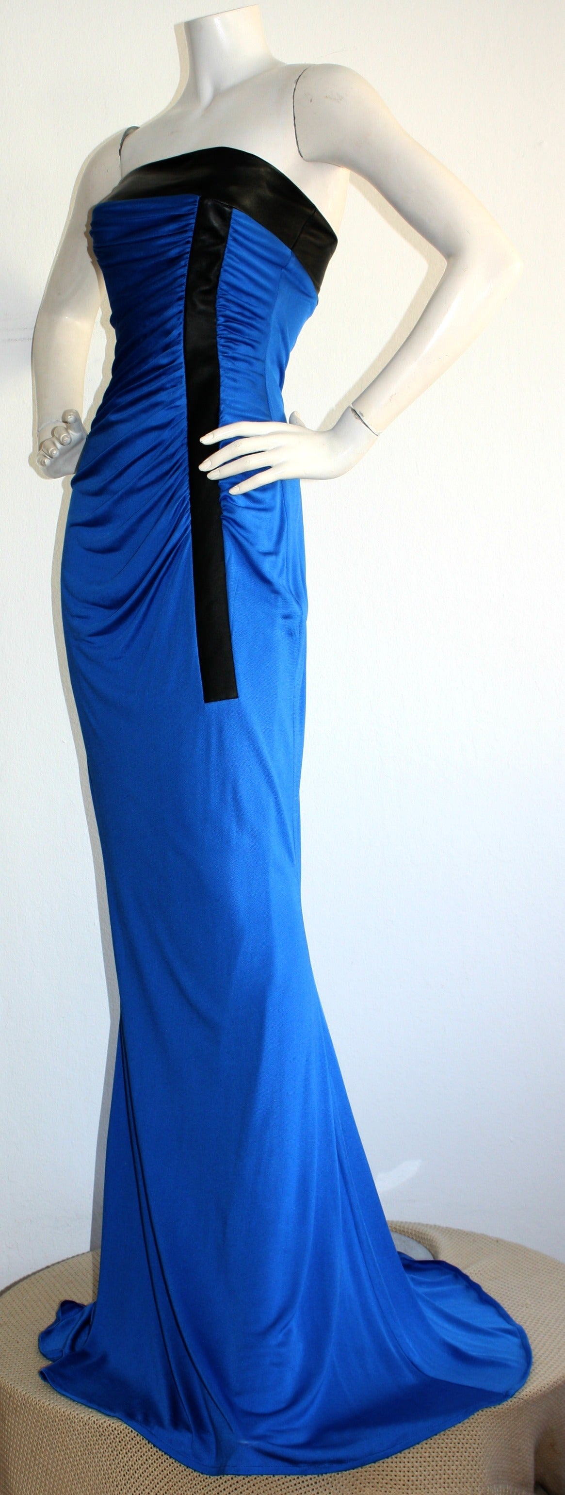 Amazing! This vintage Lloyd Klein Couture gown comes from Ivana Trump's personal collection. Auctioned off a few years back, with original auction tags still attached. Beautiful royal blue color, with black leather at bust, and down left bodice.