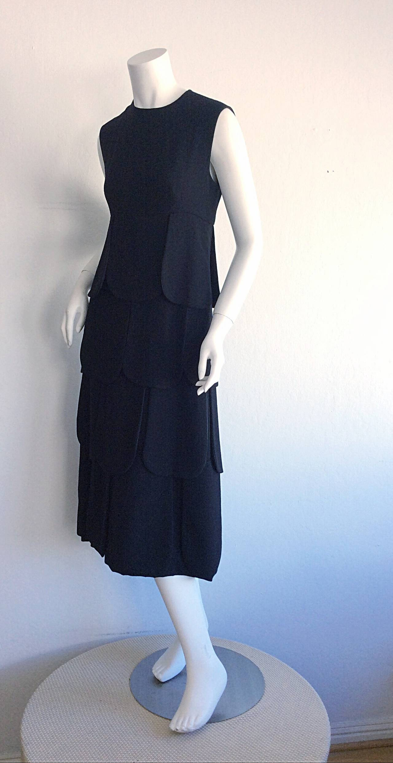 Extremely rare, and iconic 1960s Pierre Cardin 'Car Wash' dress! Intricately hand sewn, with impeccable construction. Black wool petals perfectly placed throughout the entire dress. Looks amazing on the body, and fantastic on the dance floor. Fully