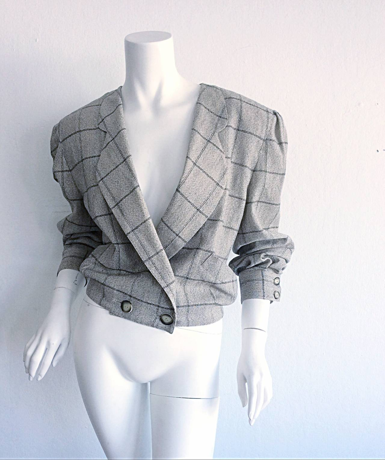 Incredible vintage Krizia 1980s boyfriend blazer! Chic double button at waist, and each cuff. Classic beige windowpane print that goes with everything! Can easily be dressed up or down. Fully lined. Made in Italy. In great condition. Approximately