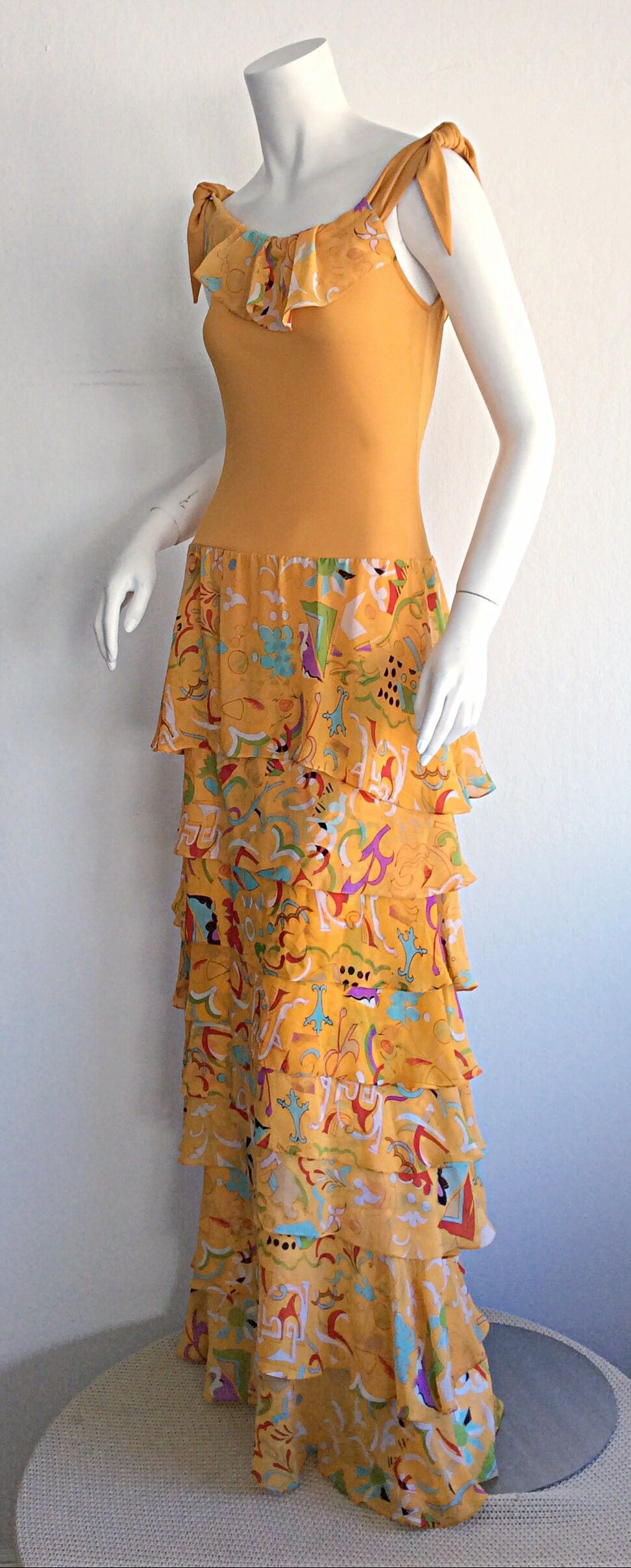 Beautiful 70s Stephen Burrows jersey maxi dress! Super flattering bodice, with incredible printed silk tiered skirt. Sleeves can be worn on arms, or off the shoulders. Sash details on each sleeve. Easily transitions from day to night. Brand new, and